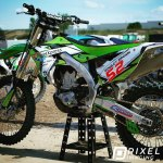 Custom-printed racing decals and company logo decals on a dirt bike.