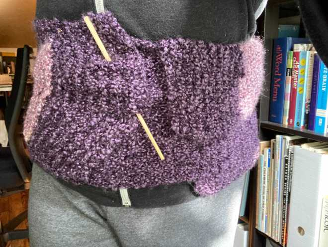 a purple scarf shown being used as a haramaki
