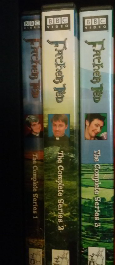 DVD spines for all three seasons of FATHER TED