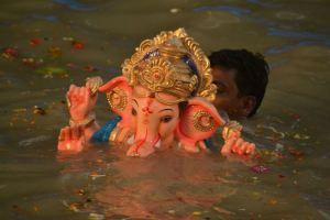 Ganesh idol partially submerged