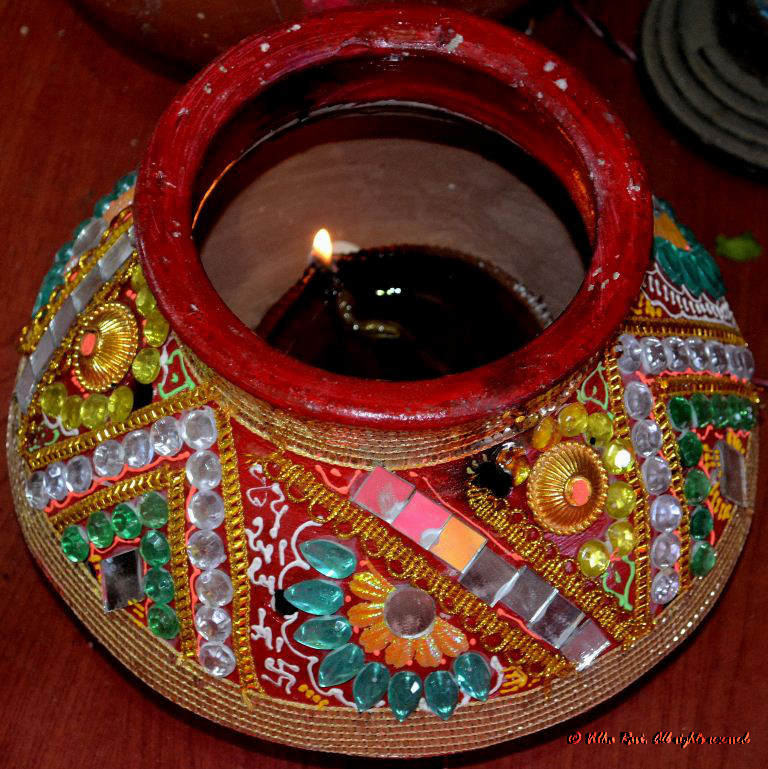 An auspicious light or diya is a must at any Indian puja
