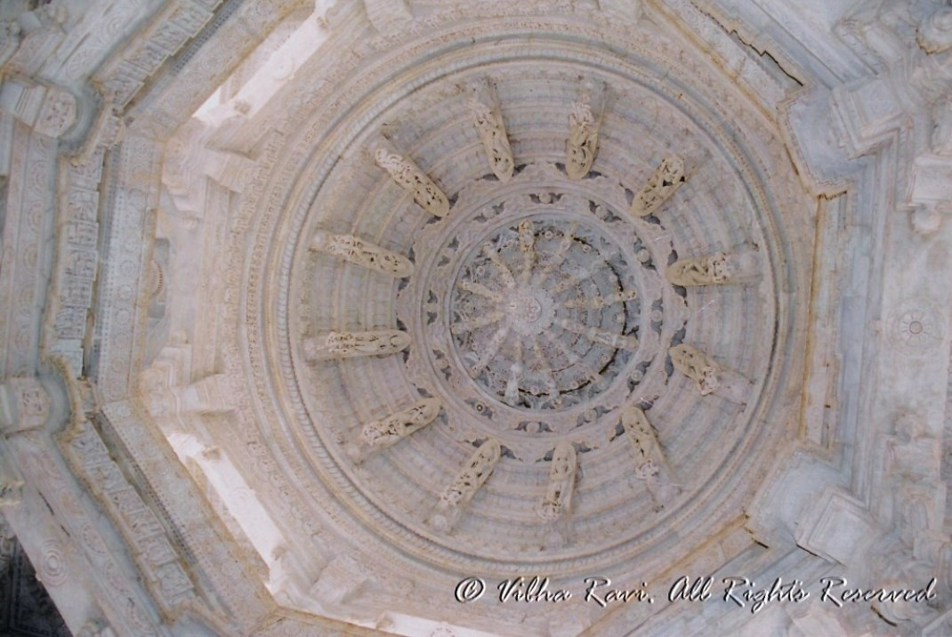 Ranakpur Temple's ornate ceiling with nymphs and gods playing musical instruments