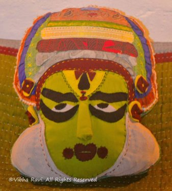 Cushion cover shaped in the form of a Kathakali artist's face