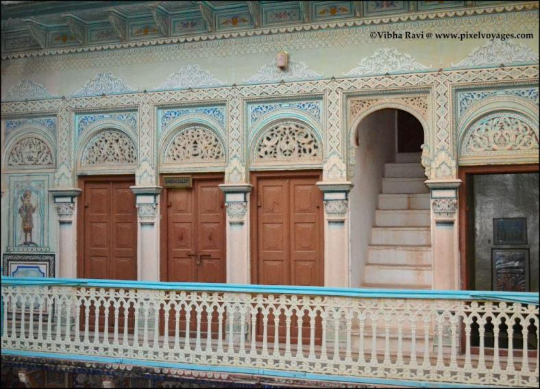 The firnee or walkway at Podar Haveli in Nawalgarh features a grille