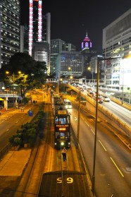 Trams line up near Lippo Centre, Admiralty. A tram driver steps out to make a call