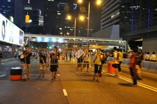 Admiralty. Protesters carry barricades