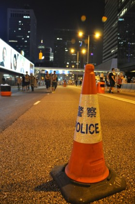 Connaught Road Central closed. Behind, protesters carry barricades