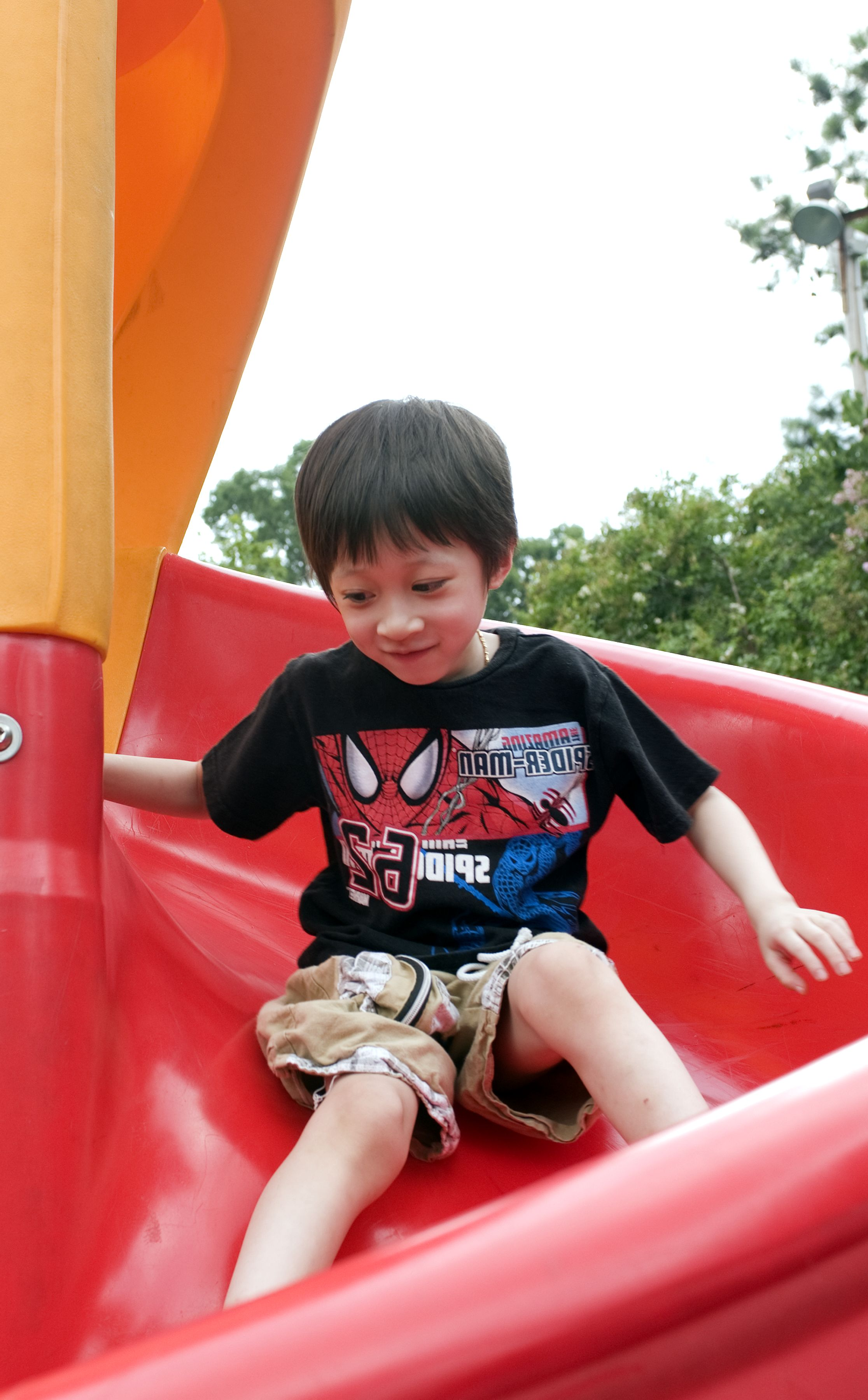 Free Picture Young Boy Taking Trip Down Bright Red Slide