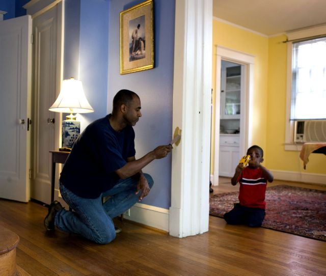Man Painting Interior Door Frame Home Young Son
