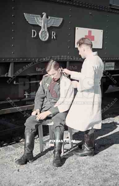 Wehrmacht Soldier Getting Haircut Near The Leipzig Main