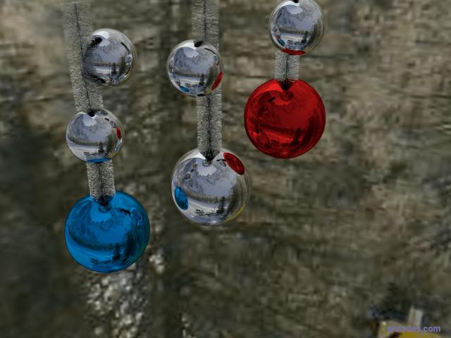Bolas y espumillón de navidad con fondo nevado