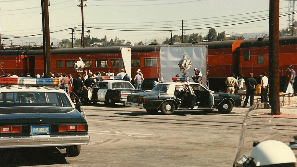 Filming a police shoot-out while Burt Lancaster and Kirk Douglas hang out the door of the baggage car.