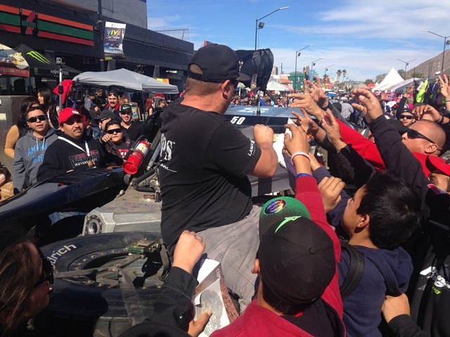 Handing out hats (or other free stuff) creates a frenzied excitement among spectators.