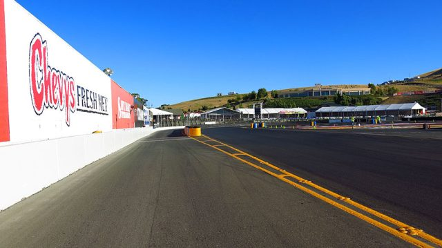 The entry to Pit Row is on the left; the Turn 11 hairpin is coming up on the right.