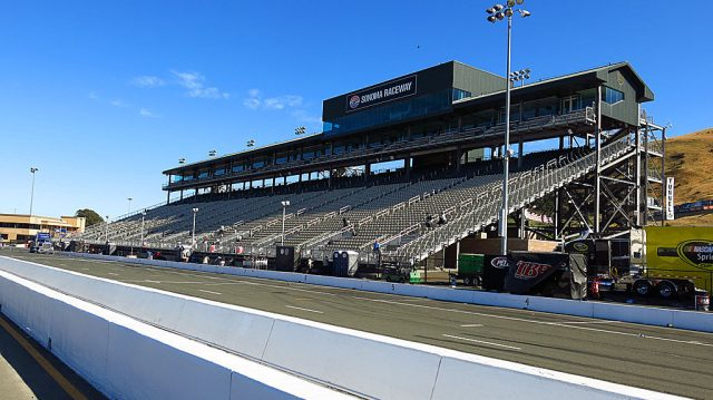 The main grandstands at Sonoma; Pit Row is in the foreground.
