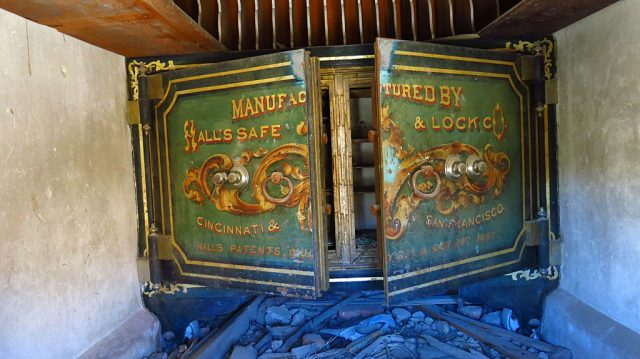 "A vault inside the Bodie Bank: ""Manufactured by Hall's Safe and Lock Co., Cincinnati and San Francisco, Hall's patents July 23 and Oct. 29, 1867."" The bank had gone untouched by the 1892 fire, but wasn't so lucky in the 1932 fire."