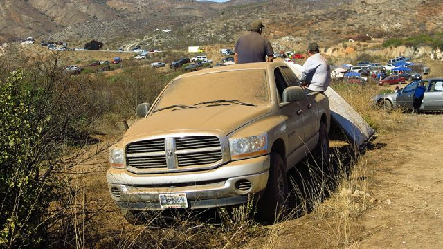 Spectating a desert race is dirty business; these guys didn't bother to roll up the windows.
