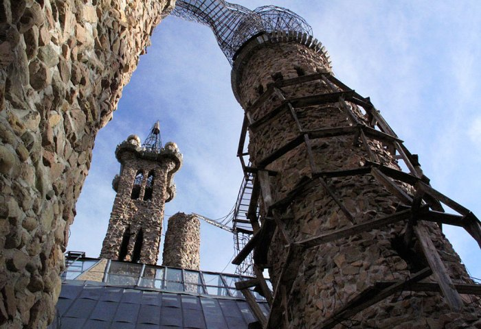 The main tower of the castle is 160' tall (left of center). On the right, a temporary wooden scaffolding is in place for exterior work.