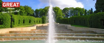 The Grand Cascade water feature in the heart of the Alnwick Garden, Northumberland. This developing garden is the inspiration of Jane, Duchess of Northumberland whose vision is to develop it into a contemporary garden that integrates water and light into a theatre of gardens. Its dramatic main feature is the Grand Cascade which is a magnificent tumbling mass of water ending in an eruption of fountains sending 350 litres of water into the air every second. The sequence lasts 12 minutes., The Alnwick Garden, Northumberland, England.