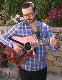 PJ playing guitar.