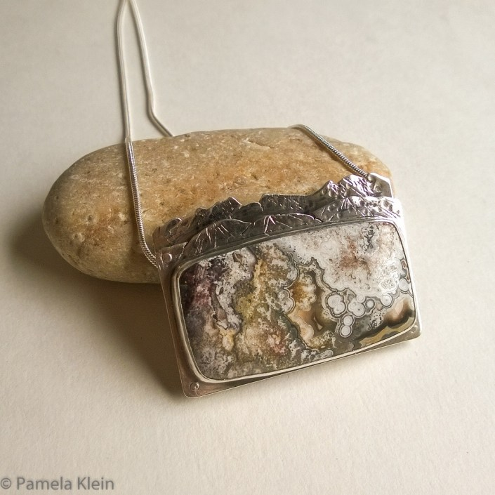 Crazy Lace Agate Riveted Mountain Pendant