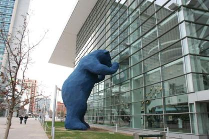 The Big Blue Bear in Denver looks in on the Denver Convention Center and has become a beloved attraction in the city.