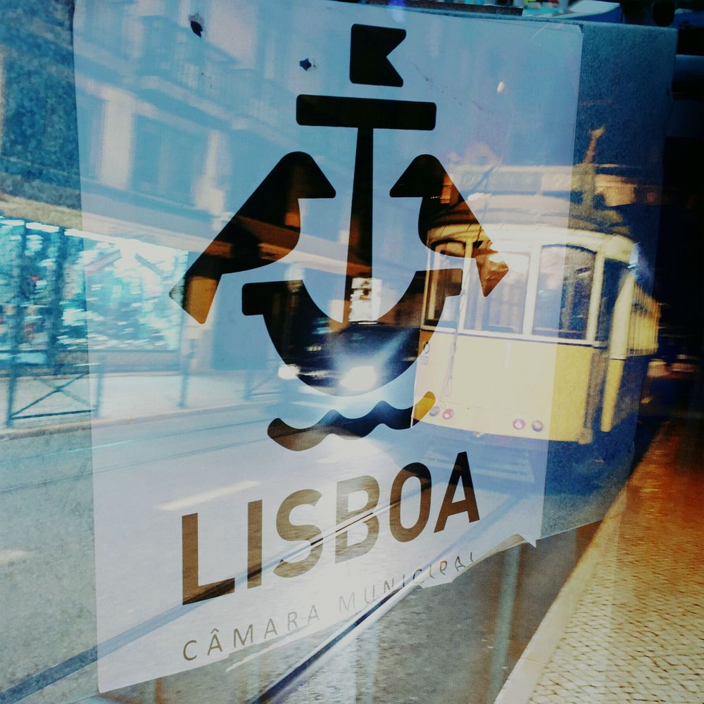 Lisbon double exposure with tram and sign
