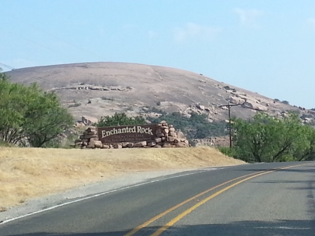 A view of Enchanted Rock from the approach.