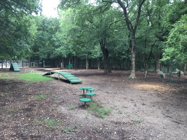 A view of the dog agility course at the dog park.