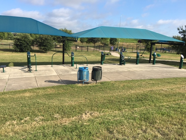 The exercise station in front of the dog park.