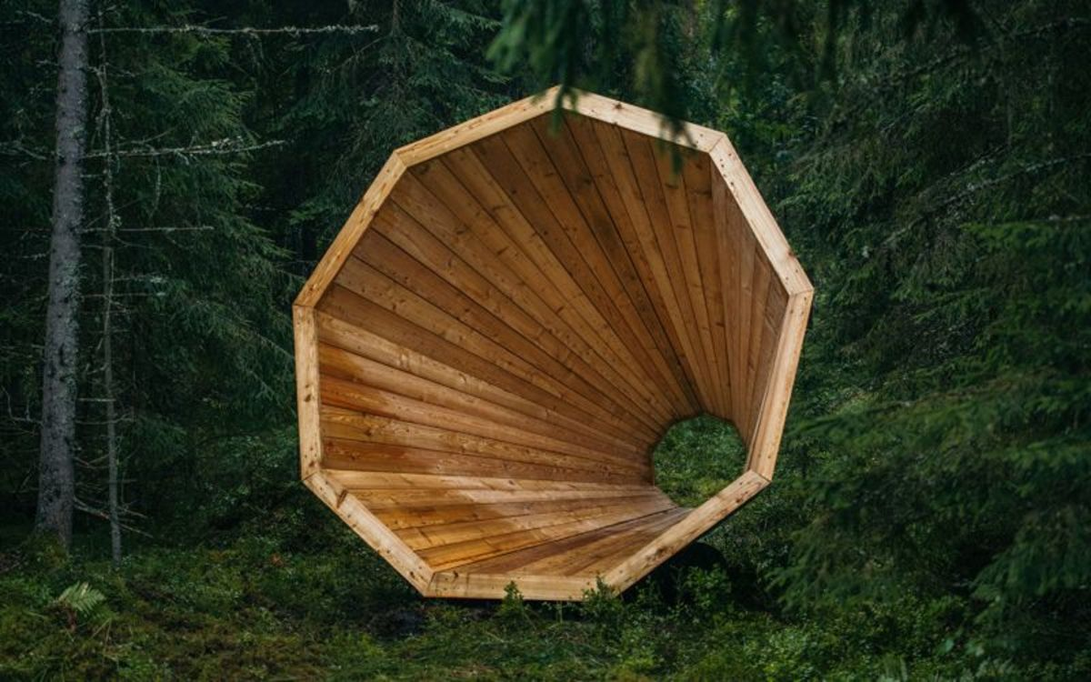 Giant Wooden Megaphones in a forest amplify nature's sounds