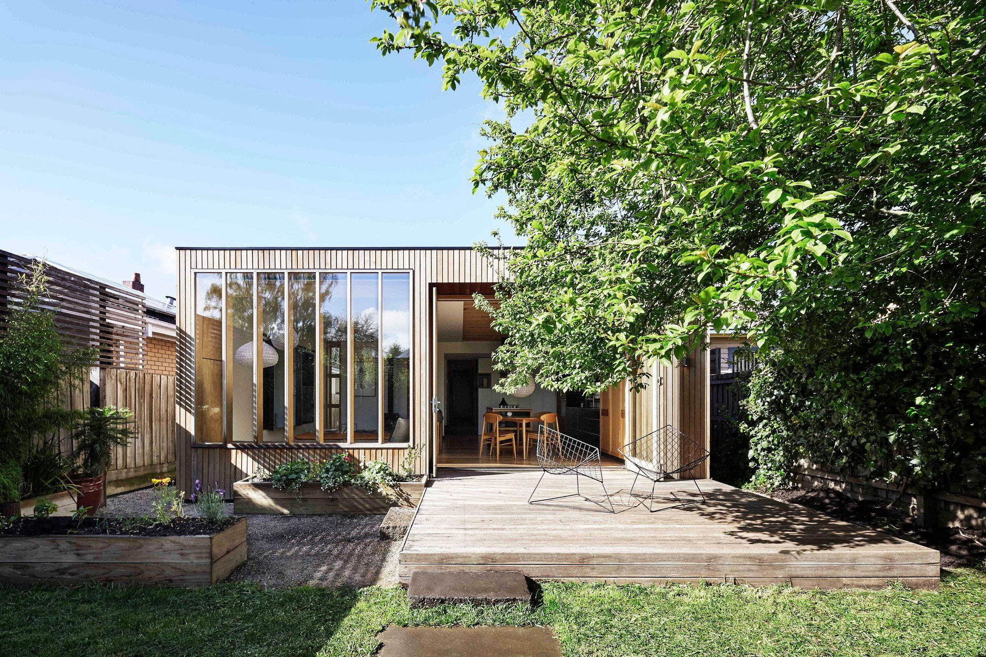 Classic Façade And Contemporary Interiors For The Wooden Box House