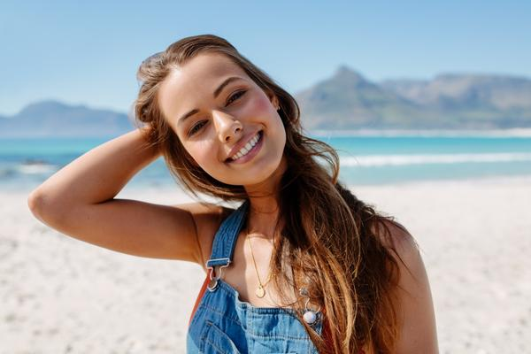 Women's on The Beach Using The Best Sunscreen for Hair and Scalp