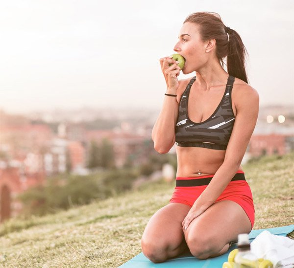 Woman Eating Healthy Food After Running