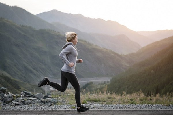 Woman Running a Mile to Check Current Health and Fitness Level