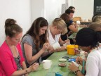 One of the activities on our outing - painting porcelain mugs. Concentrating hard, we are.