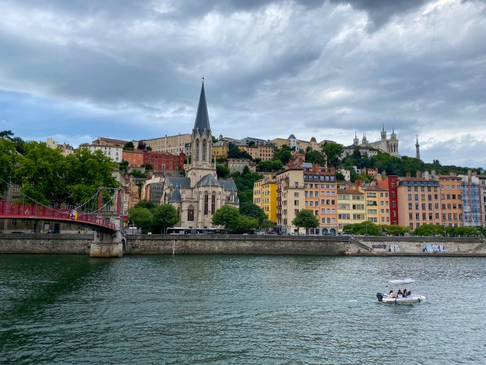 Lyon France. Saone river with a boat.