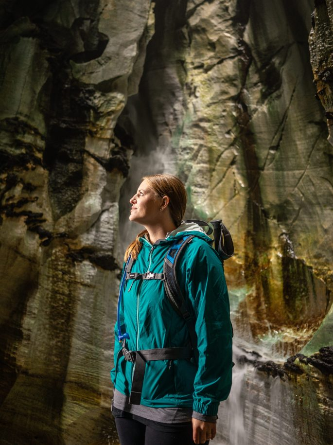 girl in a cave at Trollkirka in Norway