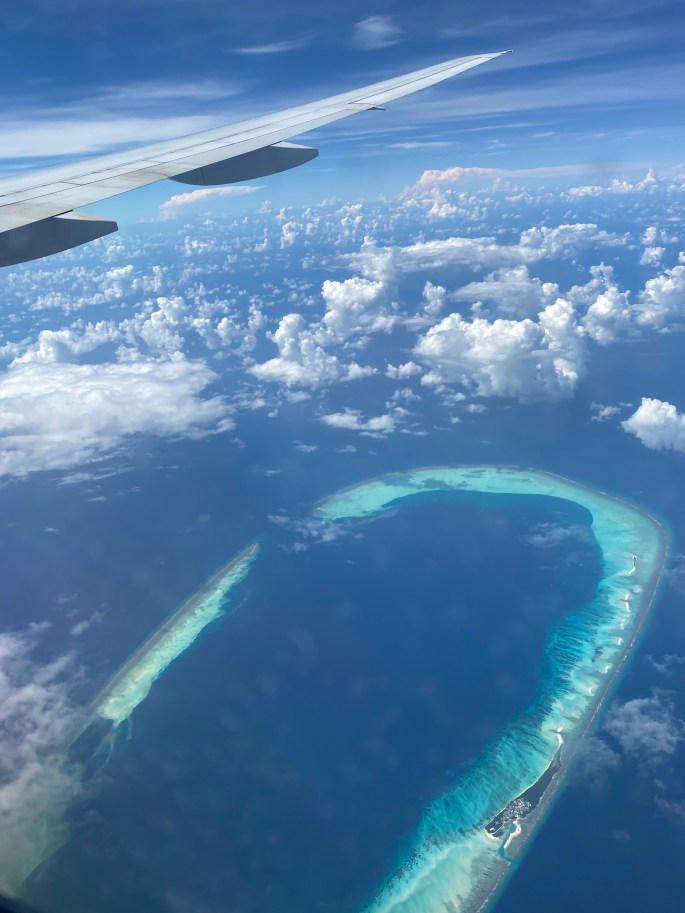 Flight over Maldives islands  for white sand Christmas vacation