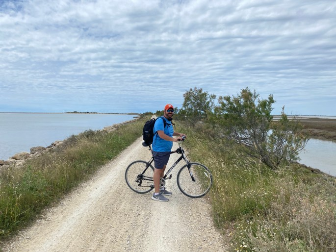 man on bike path in camargue nature reserve in france