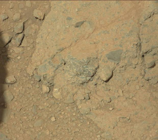 "Mastcam image of ""ribbon rock"" (middle) and surrounding terrain. Click for larger version. Credit: NASA/JPL-Caltech"