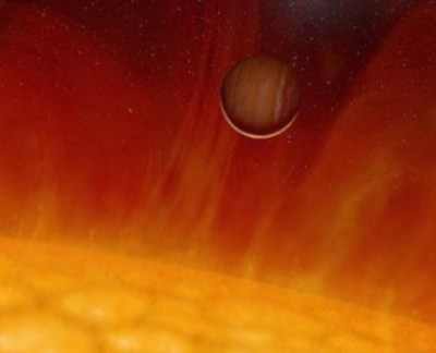 Artist's conception of exoplanet V 391 Pegasi b as it becomes engulfed by its expanding, dying red giant star. Earth faces a similar fate billions of years from now. Image Credit: HELAS/European Helio and Asteroseismology Network