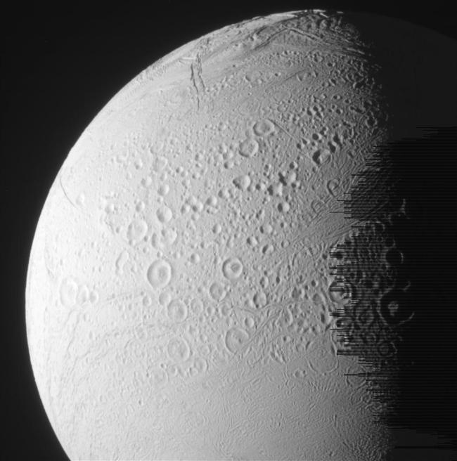 One of the recent new images of the moon Enceladus. Lines on the right side are data noise. Photo Credit: NASA/JPL-Caltech