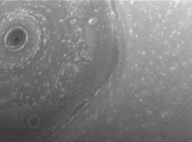 "Saturn's northern hemisphere up close: new image taken by Cassini on Dec. 3, 2016, showing small details in the turbulent atmosphere, including one corner of the ""hexagon"" with central cyclone. It was taken at a distance of about 240,000 miles (390,000 kilometers) from Saturn. Photo Credit: NASA/JPL-Caltech/Space Science Institute"