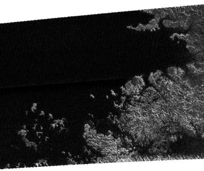 Alien seas: Cassini's radar and other instruments have shown Titan to be a world of methane/ethane rain, rivers, lakes, and seas. This view shows a shoreline of one of the seas. Image Credit: Cassini Radar Mapper/JPL/ESA/NASA