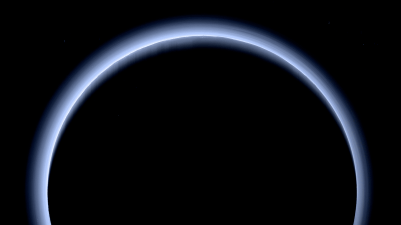 Stunning view of Pluto just after closest approach by New Horizons, with the hazy bluish atmosphere backlit by the Sun. Photo Credit: NASA/JHUAPL/SwRI
