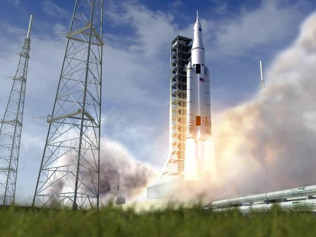 Artist's conception of the Space Launch System (SLS) launching from Kennedy Space Center. Credit: NASA