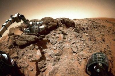 The Spirit rover examining rocks on Husband Hill in Sept. 2005. Image Credit: M. Di Lorenzo et al./NASA/JPL/Cornell Univ./File