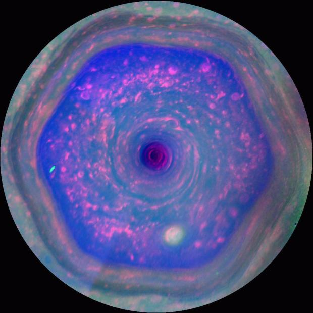 Still image from the movie sequence taken by Cassini of the colourful hexagon-shaped jet stream in Saturn's atmosphere above the north pole. Credit: NASA/JPL-Caltech/SSI/Hampton University
