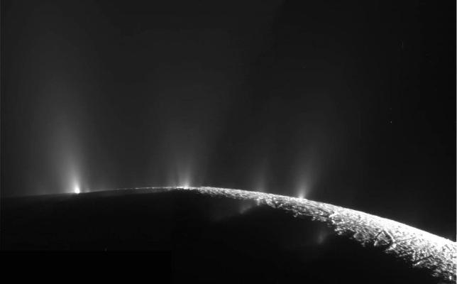 The geysers of Enceladus, erupting through cracks in the ice at the south pole from a subsurface salty ocean or sea. Image Credit: NASA/JPL